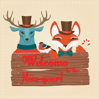 Christmas deer and fox holding wooden board