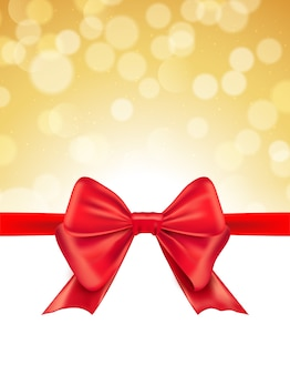 Christmas defocused bokeh background with red bow. gift card holiday celebration invitation xmas.