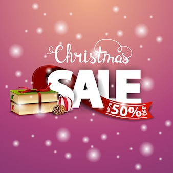 Christmas discount card with red ribbon and christmas books