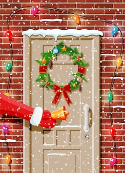 Christmas door decoration with garland and bell