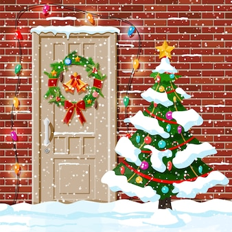 Christmas door decoration with snow and tree