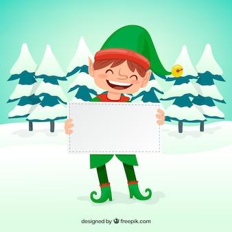 Elfo di natale che tiene una carta bianca