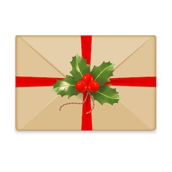 Christmas envelope for letter to santa claus closed brown envelope with berries red bow and ribbon