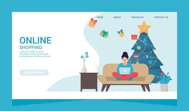クリスマスeshoppingオンラインビジネスプロモーションshopaholicコンセプト。ソファの上にラップトップを持つ顧客支払いマーケティングの女性。冬のオンラインセール。住宅購入のコンセプト。