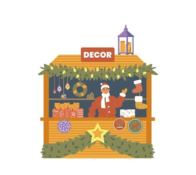 판매자와 함께 장식 양초와 기념품이 있는 크리스마스 박람회 거리 상점