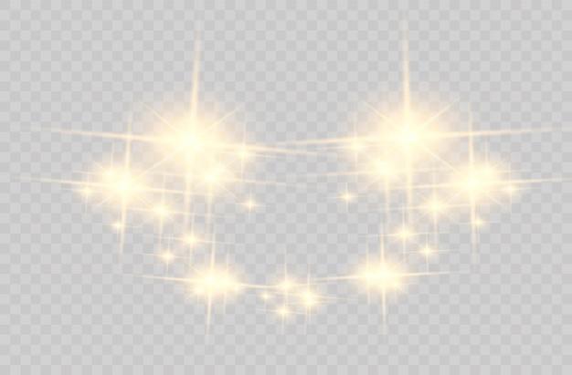 クリスマスの落ちてくる黄金の光。魔法の抽象的な金のほこりとまぶしさ。お祝いのクリスマスの背景。