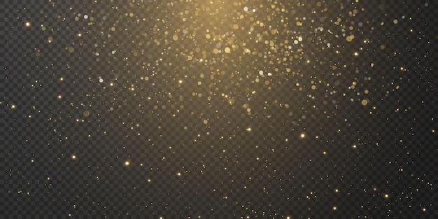 Рождественские падающие золотые огни. волшебная абстрактная золотая пыль и блики. праздничный новогодний фон.