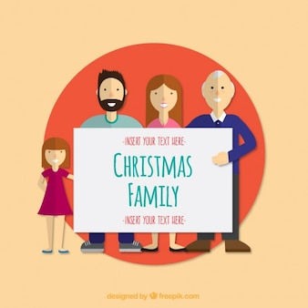 Christmas family holding a sign