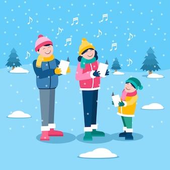 雪の中でクリスマス家族シーン歌うキャロル