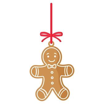 크리스마스 축제 진저 맨 쿠키는 빨간 리본으로 장식된 흰색으로 덮여 있습니다.