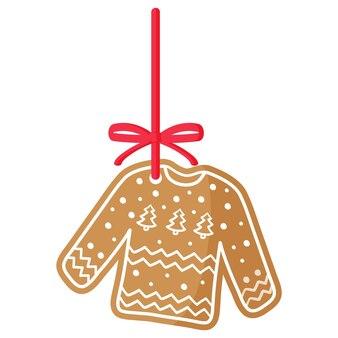 빨간 리본이 달린 흰색 장식으로 덮인 크리스마스 축제 스웨터 진저 쿠키. 기쁜 성 탄과 새 해 복 많이 받으세요 개념입니다.