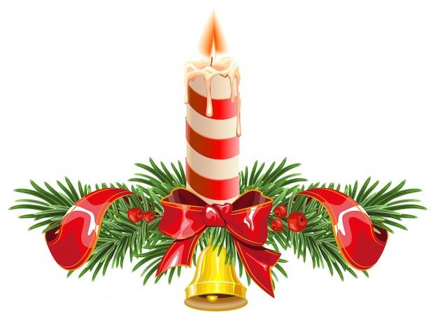 Рождественские еловые ветки с колокольчиком и свечой