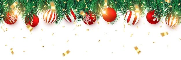 紙吹雪とクリスマスの赤いボールとクリスマスのモミの木の枝