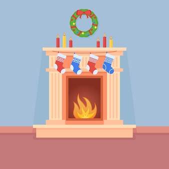Christmas fireplace with socks, candles and wreath in flat style