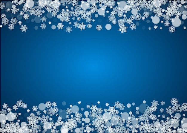 Christmas frame with falling snow on blue background. horizontal merry christmas frame with white frosty snowflakes for banners, gift cards, party invitations and special business offers.