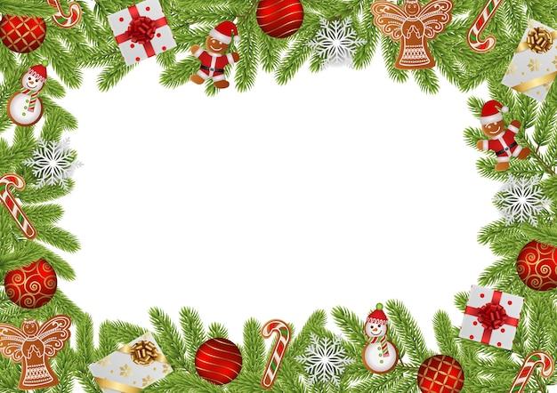 Новогодняя рамка с сосновыми ветками, пряниками, елочными шарами, снежинками и подарочными коробками