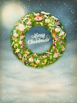 つまらないものと毛皮の木の枝が付いているクリスマスの花輪。