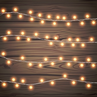 Christmas garlands isolated on wooden background