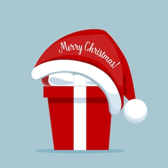サンタの帽子が付いているクリスマスギフトボックス。