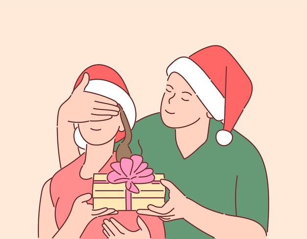 Christmas, gift, new years eve concept. young happy man has prepared surprise for his girlfriend.