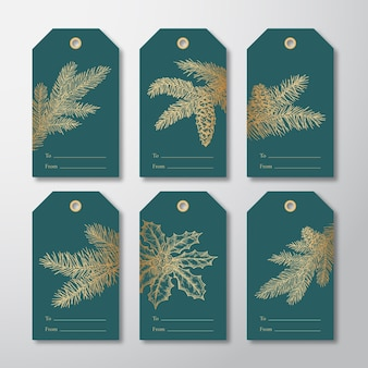 Christmas gift tags or labels set hand drawn firneedle pine branches with strobiles and holly leaf sketches golden glitter gradient