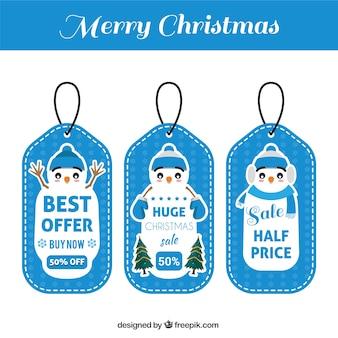 Modifiche del regalo di natale insieme con bel pupazzo di neve
