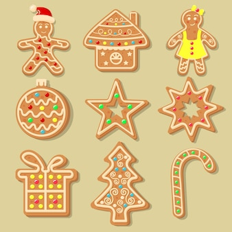 Christmas gingerbread cookies in the shape of christmas ball, christmas tree, candy, star, house, snowflake, gift and gingerbread men. sweet homemade glazed biscuits.