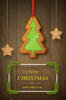 Christmas gingerbread on dark wooden  with wishes, pine branches.