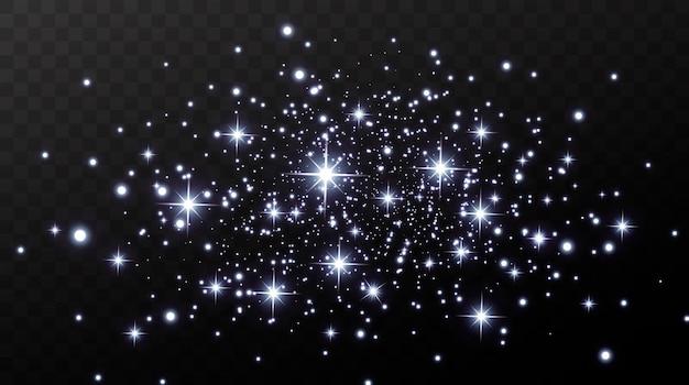 크리스마스 골드 색종이 별이 떨어지고, 빛나는 별이 우주의 빛이 반사되는 가운데 밤하늘을 날아갑니다. 휴일 배경입니다. 마법의 빛.
