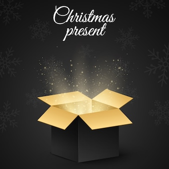 Christmas golden box with a secret gift for the holiday.