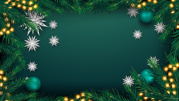 Christmas green background for your arts with garland, frame of christmas tree branches, green balls and paper snowflakes, top view