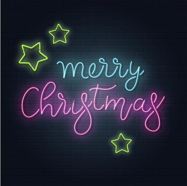 クリスマスのグリーティングカード、背景。レンガの背景にネオンスタイルのクリスマスレタリング。青と紫のネオン色、ネオンスター。手描きのレタリング。図