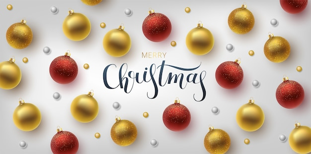 Christmas greeting card, background.gold and red christmas ball. hand drawn lettering.
