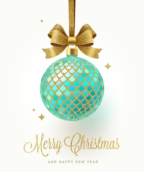 Christmas greeting card - ornate christmas bauble with glitter gold pattern.