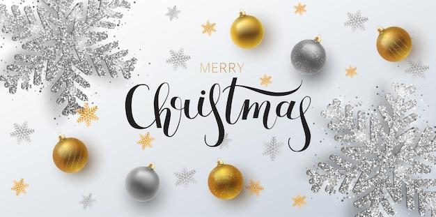 Рождественская открытка, веб-баннер, фон. золотой и серебряный рождественский бал, с орнаментом и блестками. металлическая золотая и серебряная новогодняя снежинка. рука нарисованные надписи