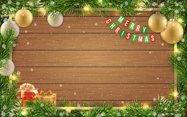 Christmas greeting card with fir tree frame, golden christmas ball and space for congratulatory text on wooden background with snowflakes.
