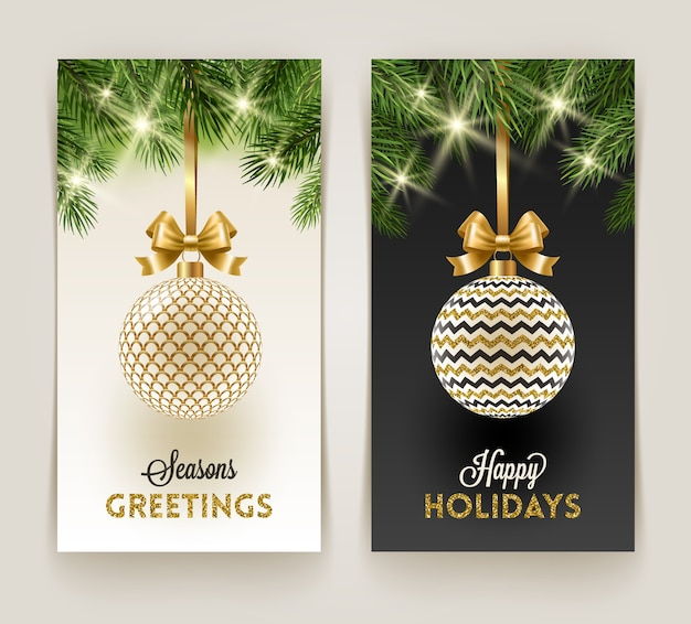 Christmas greeting cards - patterned bauble with golden bowknot hanging on a christmas tree branches