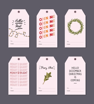 Christmas greeting gift tags set with winter elements and holiday lettering wishes