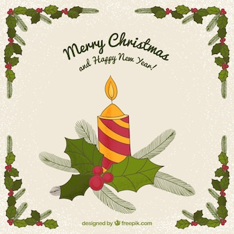 Christmas greeting of hand drawn candle and mistletoe