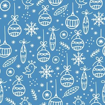 ライトブルーのシームレスなパターンでクリスマス手描きの白い飾り