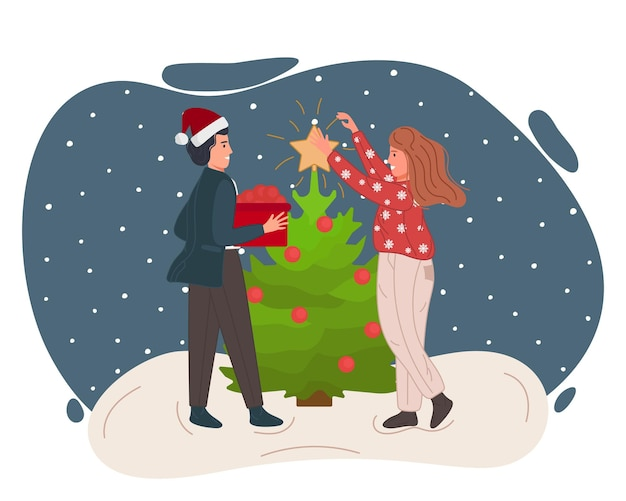 Natale e felice anno nuovo le persone che celebrano gli uomini con la donna decorano insieme l'albero di natale