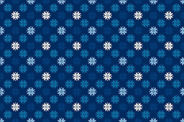 シームレスな雪片の飾りとクリスマス休暇のピクセルパターン