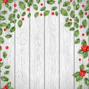 Christmas holly on a wooden background. and also includes
