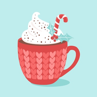 Christmas hot chocolate with cream and candy cane.