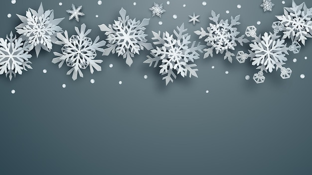 Christmas illustration of white complex paper snowflakes with soft shadows on gray background