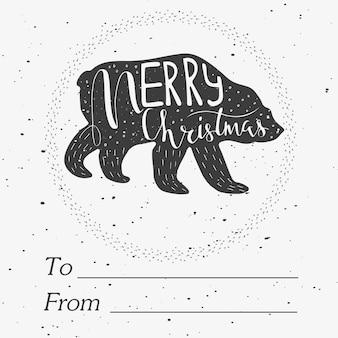 Рождественские иллюстрации с handdrawn буквами. забавный полярный медведь с цитатой с рождеством на снежном фоне. симпатичные иллюстрации для открытки, плаката, футболки, баннера.