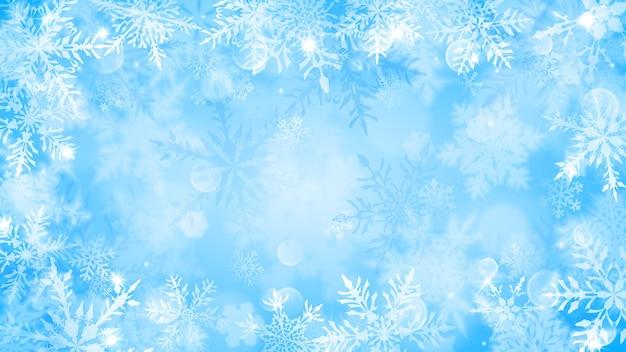밝은 파란색 배경에 흰색 흐릿한 눈송이, 눈부심 및 반짝임이 있는 크리스마스 그림