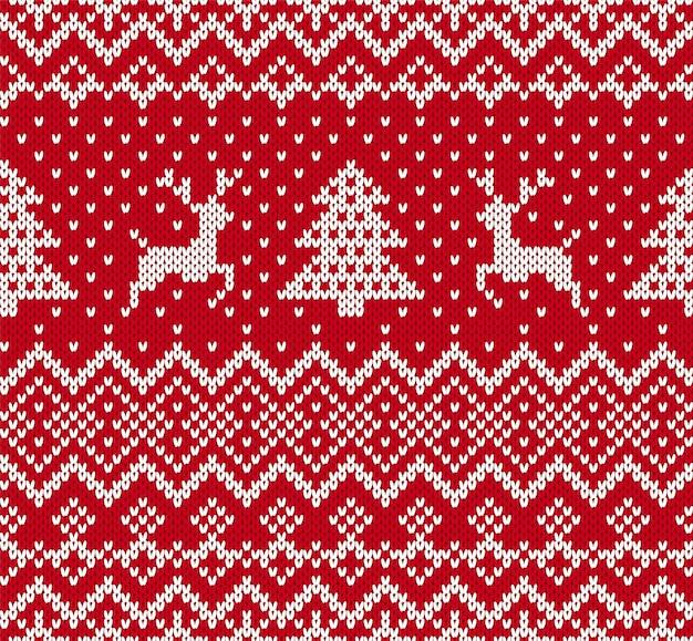 赤と白の色のエルクとクリスマスツリーとクリスマスニットの幾何学的な装飾。ニットのシームレスなパターン。
