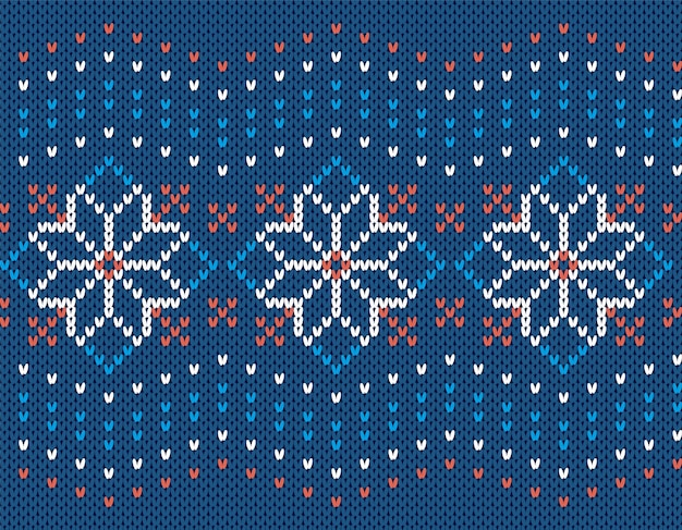 Christmas knit seamless pattern. blue knitted sweater texture. print with flowers. xmas background.