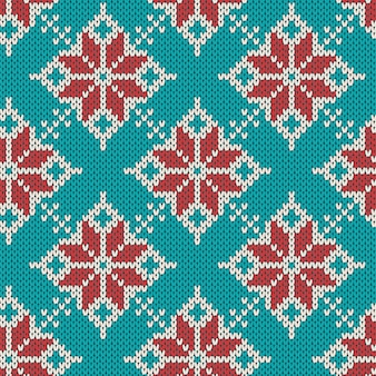 Christmas knitting seamless pattern with geometrical snowflakes. knitted blue sweater .